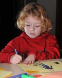 Signing her artwork