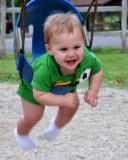 Mason enjoying a swing ride