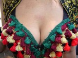 Tassled cleavage   I wonder what happens when you pull that tassel over there