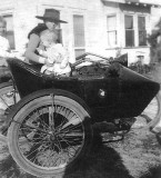 1920 - little James (left) and Jack High with their mom Ruby High in the sidecar of an Indian motorcycle
