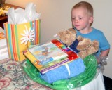 August 2008 - Kyler with some presents from us