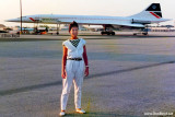 A young European lady with a British Airways Concorde in the background at Miami International Airport