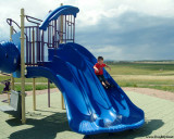 July 2009 - Kyler on the big slide at playground at Peterson AFB, Colorado