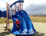 July 2009 - Kyler on the small slide at playground at Peterson AFB, Colorado