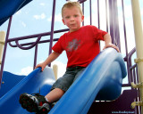 July 2009 - Kyler at the top of the big slide at the playground at Peterson AFB, Colorado