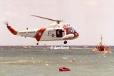 Early 1980's - air crew members of CG Reserve Unit Air Station Miami in wet drill training with HH-52A #CG-1419