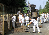 UNLOADING THE WICKER TOBOGGANS