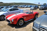 1965 Shelby Cobra stands out at Laguna Seca's dusty parking lot during the 2008 Monterey Historic Automobile Races.