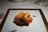 Kagoshima beef tenderloin with polenta and white asparagus served on a sweet and sour sauce of San Marzano tometoes