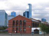An old railway shed against the city background