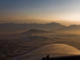 Sunrise over Kabul, turning to gain altitude