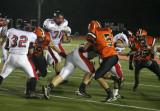 schlosser tackles the milford ball carrier