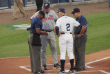 Charlotte manager Jim Morrison exchanges lineups with Jeff Smith of Fort Myers