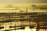 Sunrise over fish cages in Lake Sebu, South Cotabato
