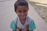 Boy Smiling on Stuppa in Buddhist Monastery.jpg