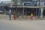 People Waiting for Bus Outside Dhaka.jpg