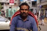 Rickshaw Driver Outside Lalbagh Fort.jpg
