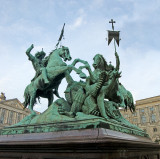 St. Georg fighting the Dragon in St. Nicholas Quarter, Berlin - two picture composite