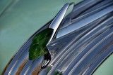 Matching green Chief Pontiac hood ornament