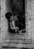 Boy in a window, Ta Prohm
