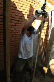 John man-handling the drilling rig