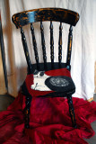 Painted cat on a chair