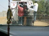 519 Overcrowded bus going about 40 MPH on rutted road.jpg