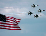 Quartet Trailing Smoke Past Flag.jpg