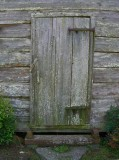 Door to hewn-log shed 4221