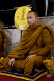 Monk In Thought as the Prayers are Read