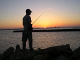 04-16-04 daniel fishing in sunset.jpg