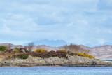 Samalaman Island with the Cuilin Hills on Skye beyond