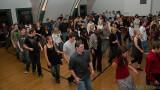 Full house doing a line dance