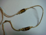 Lead 10-Gold and white cord with golden brown bead and gold accents