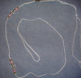 Lead 16-White cord with flower bead and pink accents