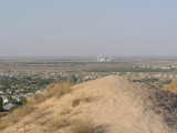 Near Ashghabad, Turkmenistan - Ruins of Nissa - view of new mosque in nearby city