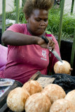 Opening coconuts, Honiara Central Market