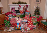 A BIG PILE OF CHRISTMAS GIFTS AWAIT THE FAMILY