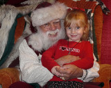 GRANDDAUGHTER WITH SANTA