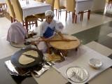 Preparing bazlama (Turkish flat bread) for hotel guests