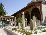 Tombs and ablution fountain in front of Mevlana Museum in Konya