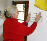 Shalom Free Clinic Executive Director and co-founder Nancy Morgans-Ferguson does her weekly ritual of putting up temporary signs
