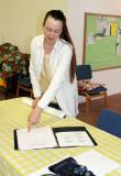 Shalom Free clinic acupuncturist Jennie Hammett checks her itinerary