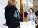 Chico High School student and Shalom Free Clinic greeter welcomes a patient