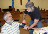 Chico's Mike Jensen, at the Shalom clinic for counseling and acupuncture gets blood pressure taken by localparamedic Mark Walker