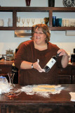 Donna shows off a new use for a wine bottle