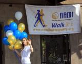 Super volunteer Ashley hangs balloons