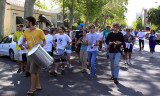 Drummers lead the walk down Third Street