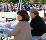 Parade announcers Debbie Cobb and Larry Scott