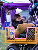 Small girl, part of a couple of families who brought pimped out wagons to the show